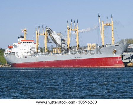 A huge ship at the harbour - stock photo