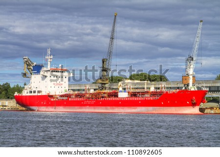 A huge ship moored to a wharf - stock photo