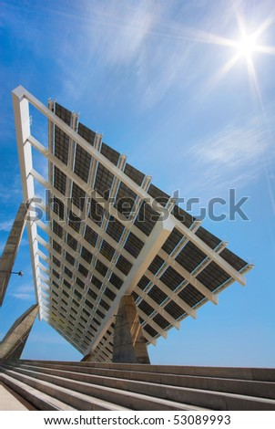 "A huge solar panel under the sun rays. It's located in the ""forum"" area of Barcelona. This version has been shot using a rectilinear wide angle lens. - stock photo"
