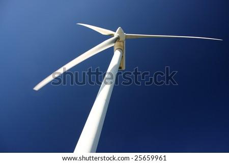 A huge wind turbine from below - stock photo