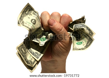 a human hand holds a fist full of money isolated on white