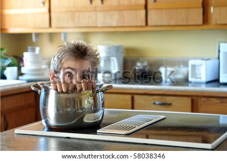 A human head being cooked in a soup pot on the stove with steam coming up - stock photo