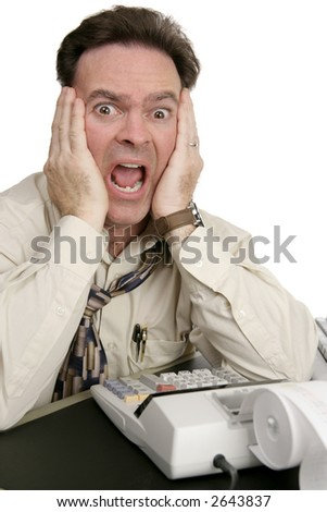 A humorous photo of a very shocked man doing his accounting.  Isolated on white. - stock photo