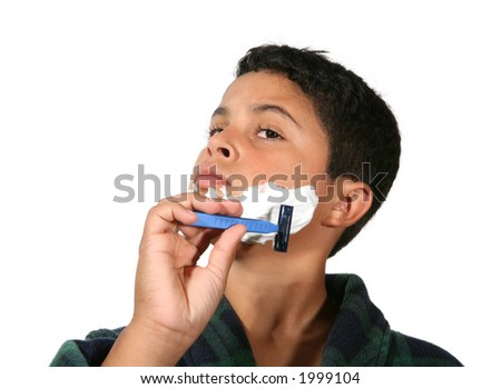A humorous shot of a young boy shaving - stock photo