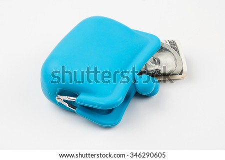 A hundred dollars in a small blue purse on a white background