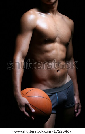 a hunky asian basketball player in boxer trunks - stock photo