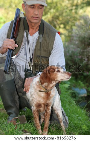 a hunter and his dog - stock photo