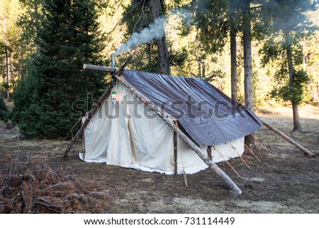 A hunting canvas tent with smoke billows out the chimney from the wood stove. Tent & Non-hunting Stock Images Royalty-Free Images u0026 Vectors | Shutterstock