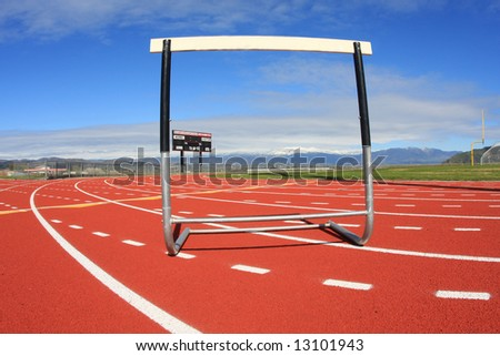 A hurdle at a high school track, representing obstacles in our lives. - stock photo