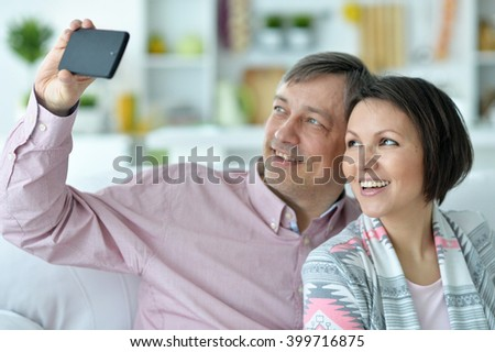 a husband and wife make selfie home - stock photo