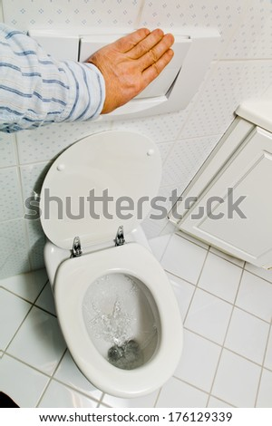 a hygienic flush toilet in a household. bathroom and toilet - stock photo