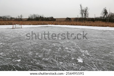 A ice hockey net on an outdoor pond rink.  - stock photo