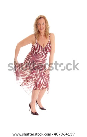 A image of a happy blond woman dancing in a summer dress, 