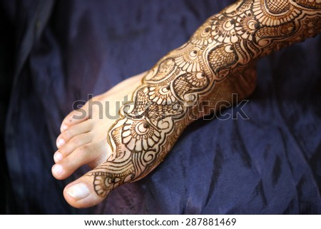 A Indian bride's feet with beautiful traditional design of mehendi.