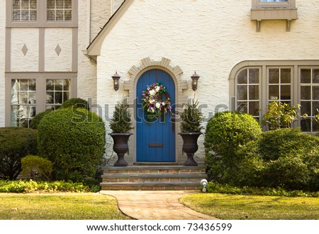 A inviting facade and door on a lovely home - stock photo