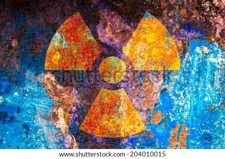 A ionizing radiation symbol on rust metal plate - stock photo