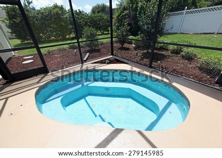 A jacuzzi in the pool area of a home - stock photo