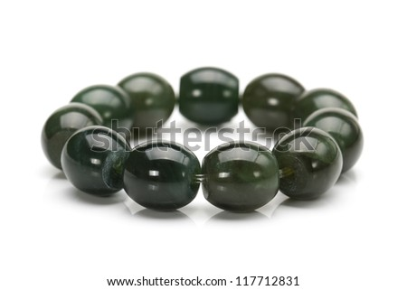 A jade bracelet on white background