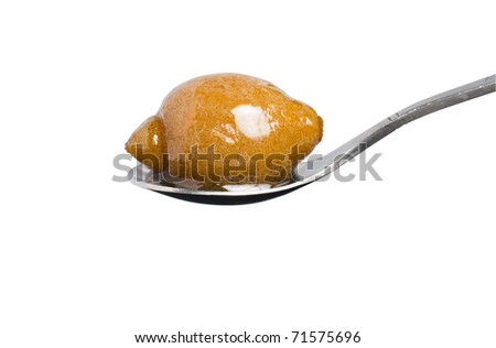 a jam on spoon, isolated on white