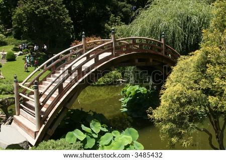 a Japanese bridge and garden - stock photo