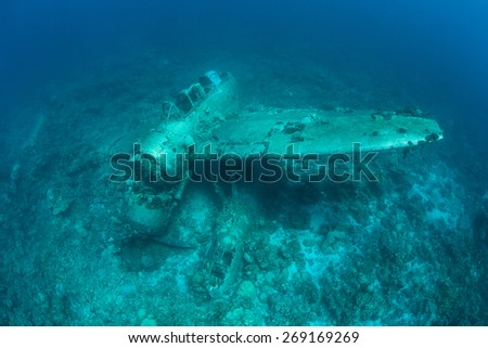 """A Japanese """"Jake"""" sea plane, shot down during World War II, sits on a coral reef in Palau. Shipwrecks and planes from the war are still being discovered in this remote Micronesian island-nation. - stock photo"""