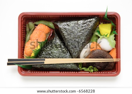 A Japanese lunch box with a variety of goodies.
