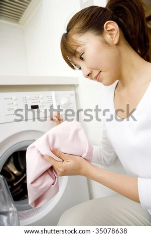 A Japanese woman  washing clothes - stock photo