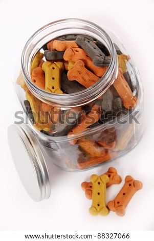 A jar brimming with dog bones in festive Halloween/Fall colors.