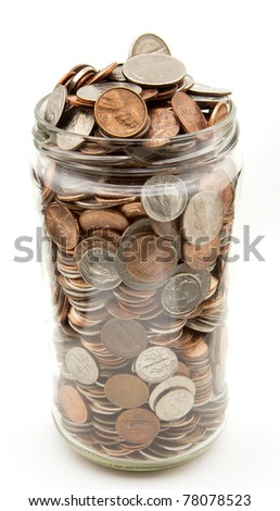A jar filled with coins - stock photo