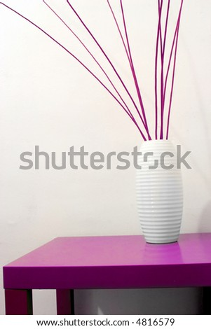 a jar full of wicker sticks, on a table - stock photo