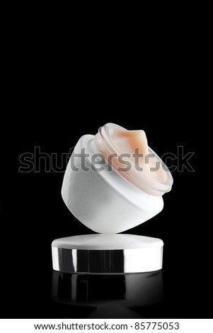 A jar of a cosmetic cream. Beauty concept. - stock photo