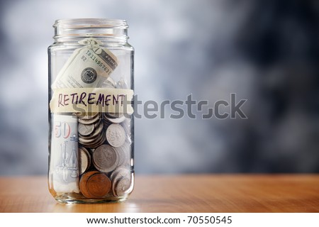 A jar of cash on the table.