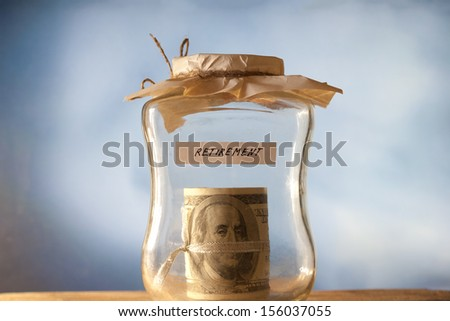 A jar of cash on the table. Retirement. - stock photo