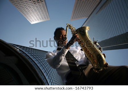 a jazz musician plays his saxophone with skyscrapers behind him as his audiance