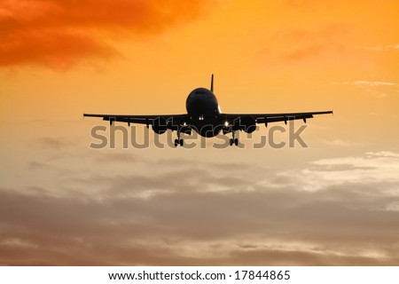 A jet air plane in the sunset - stock photo