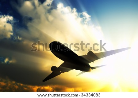 A jet flies away in the rays of sun. - stock photo