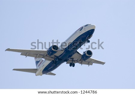 A jet landing (Boeing 737) over a blue sky