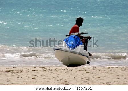 a jet ski rider taking a rest - stock photo