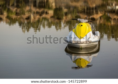A Jetski parked on the still waters of lake langano - stock photo