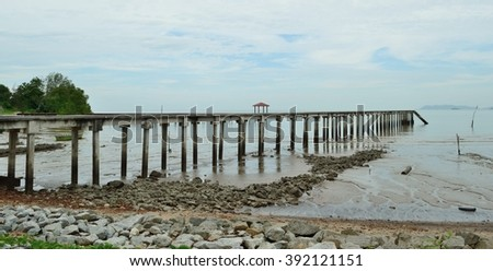A jetty at Pasir Panjang, a small coastal town near Port DIckson in Malaysia. Overlooking the jetty is the Strait of Malacca.