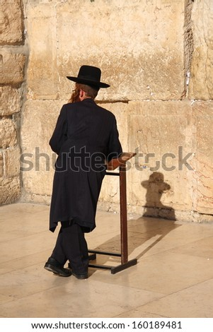 A jew prayer near the Western Wall in Jerusalem  - stock photo