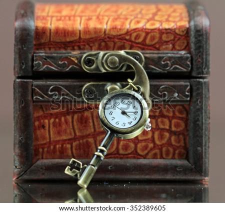 A jewelry box with a key watch. - stock photo