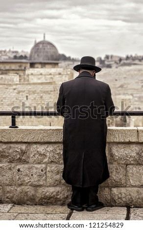 A Jewish Man Praying at the Western Wall, Kotel, Jerusalem Israel - stock photo