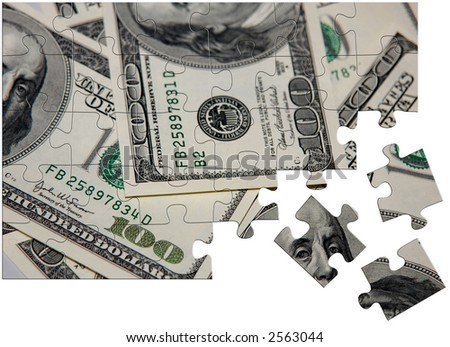 A jigsaw puzzle with hundred dollar bills. - stock photo