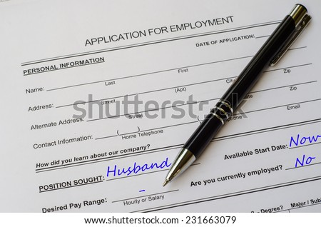A job application jobs sitting with a pen, applying for a husband - stock photo