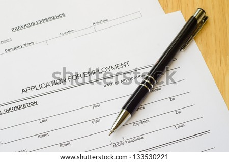 A job application jobs sitting with a pen, applying for a job