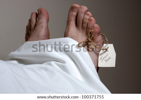 A John Doe name tag on the foot of a body - stock photo