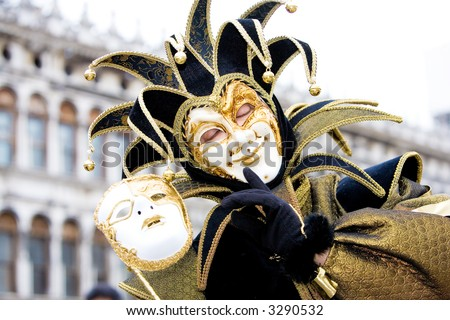A joker with his mask at the Venice carnival - stock photo