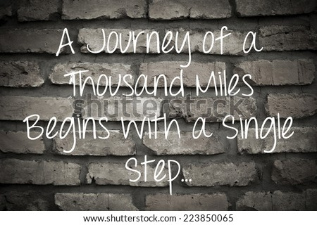 A Journey of a Thousand Miles Begins with a Single Step / Inspirational Motivational Quote Background Design  - stock photo