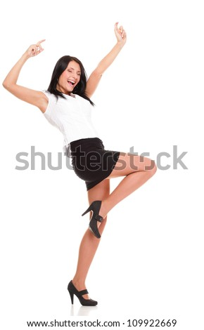 A joyous young female business executive celebrating success with raised hands on white - stock photo